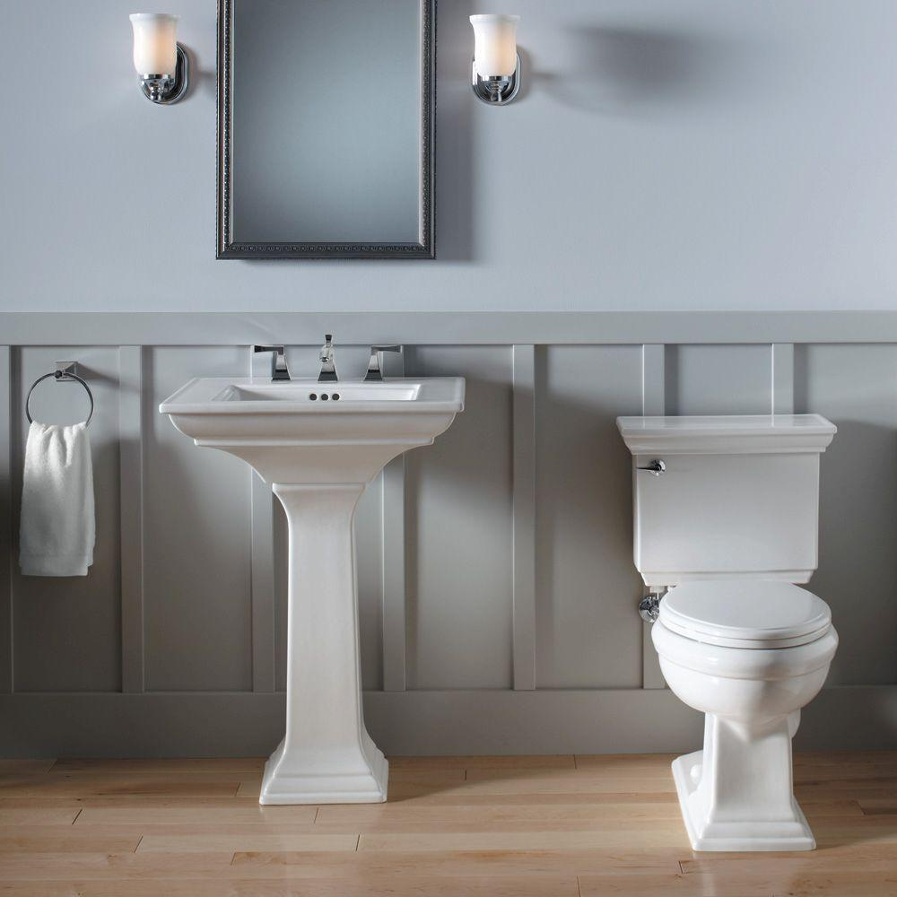 white kohler sinks with faucet under the mirror plus double lighting on the wall ideas