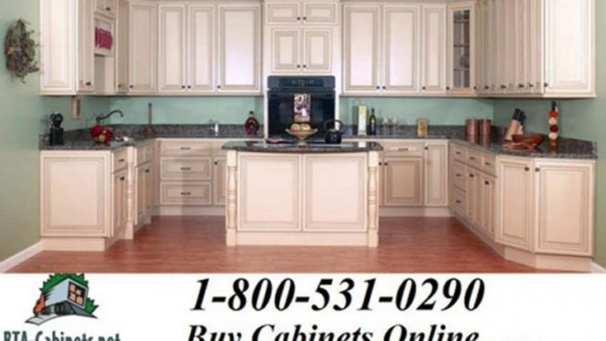 White Lafata Cabinets With Oven Plus Wooden Floor For Kitchen Design Ideas