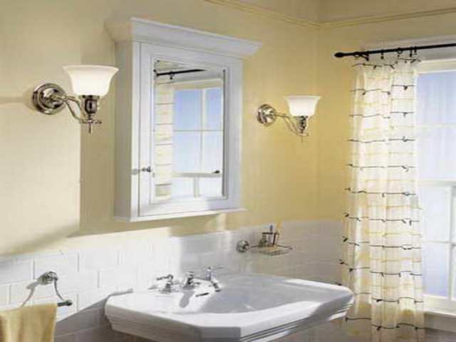 white Lowes Medicine Cabinets on cream wall with double lamp plus white sink and faucet