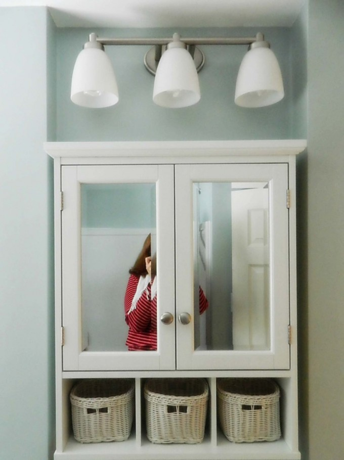 White Lowes Medicine Cabinets With Simple Design And Mirror At Surface Plus Triple Lamp On Bathroom With Blue Wall