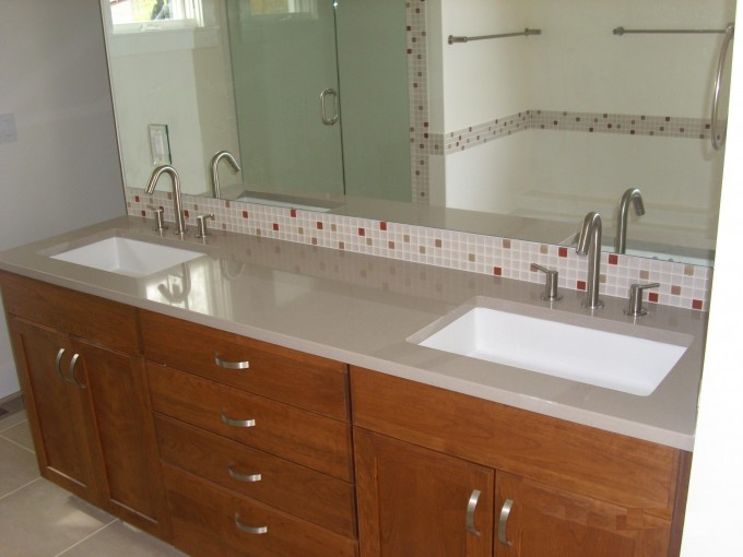 White Marble Countertop By Caesarstone Plus Double Sinks And Double Faucets