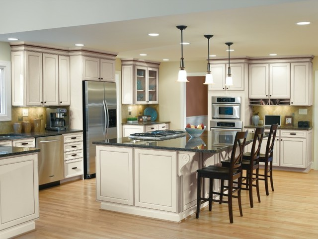 white oak aristokraft cabinets with oven and frige on wooden floor for kitchen design ideas