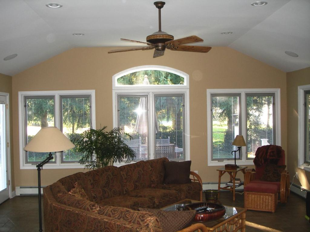 white pella windows and door matched with burly wood wall plus ofa set and fan ceiling ideas