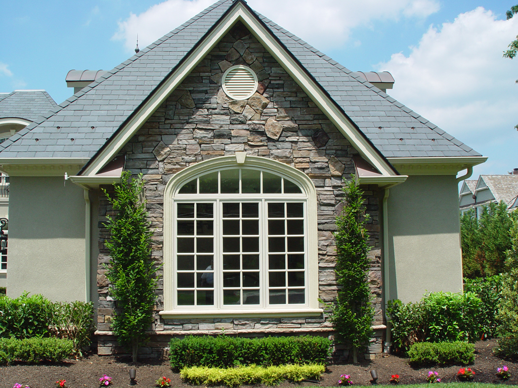 white pella windows matched with natural stone wall for exterior ideas