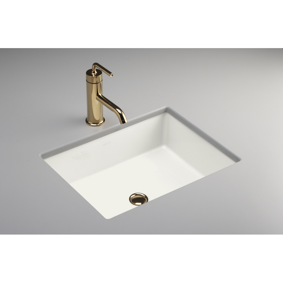 white rectangle kohler sinks with golden faucet and gray countertop ideas