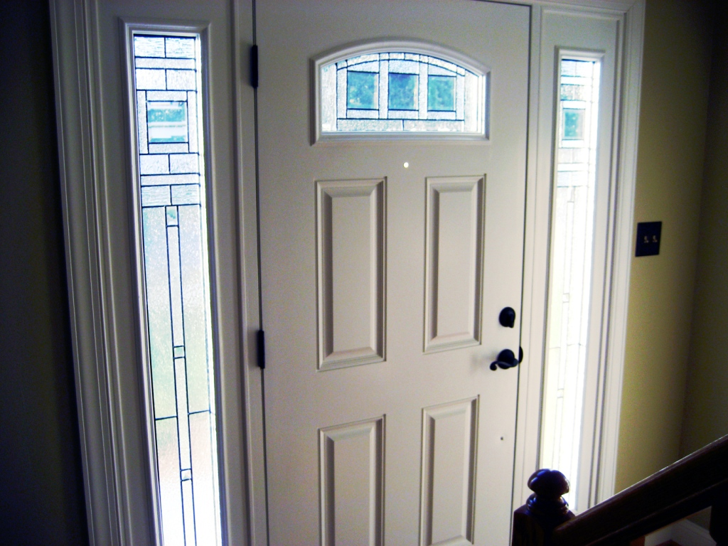white reliabilt doors with black handle matched with double glass window