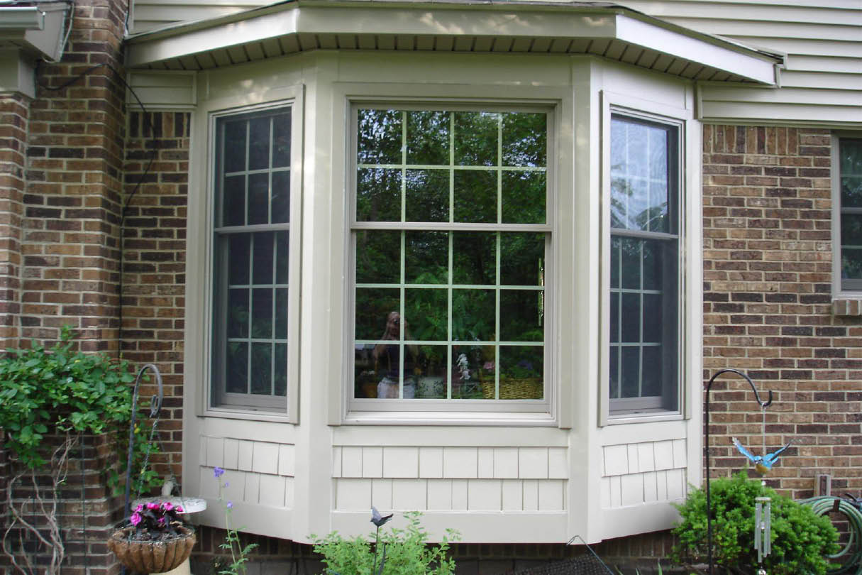 white single hung Pella Windows matched with brick wall for exterior decor ideas