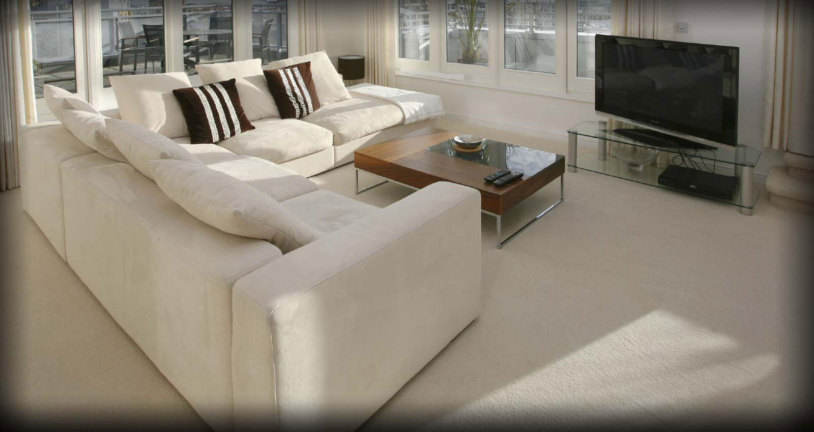 white solid masland carpet with white sofa plus cushions and wooden table ideas