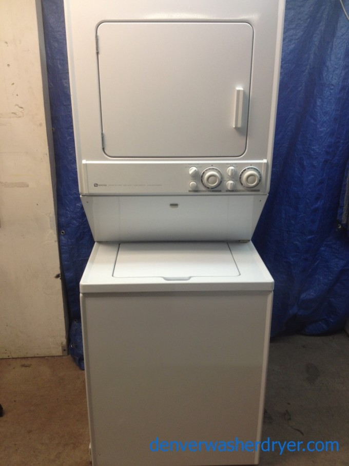 White Stackable Washer And Dryer Befor The Blue Curtain