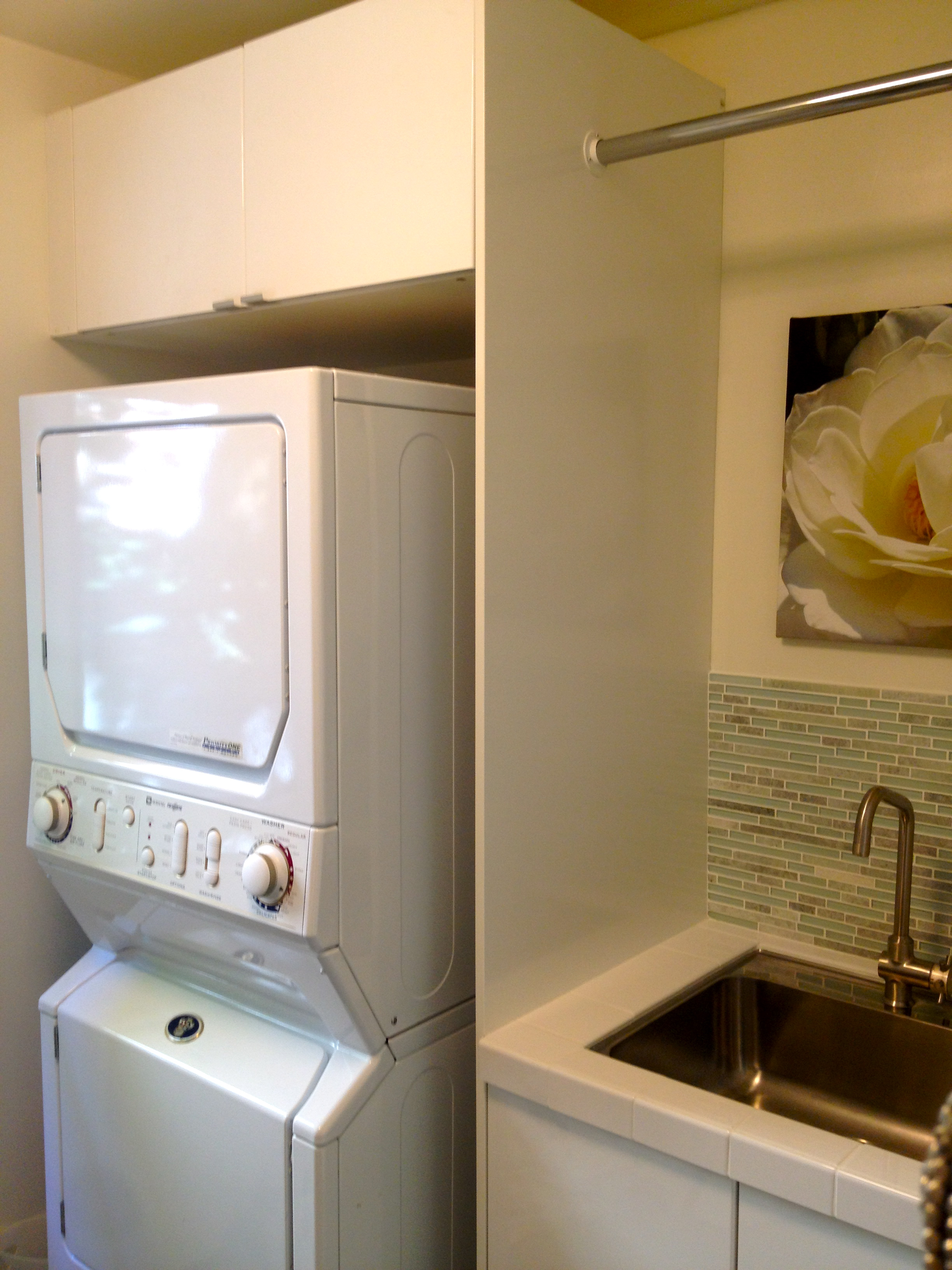 White Stackable Washer And Dryer Near The Sink With Faucet On Laundry Room Ideas