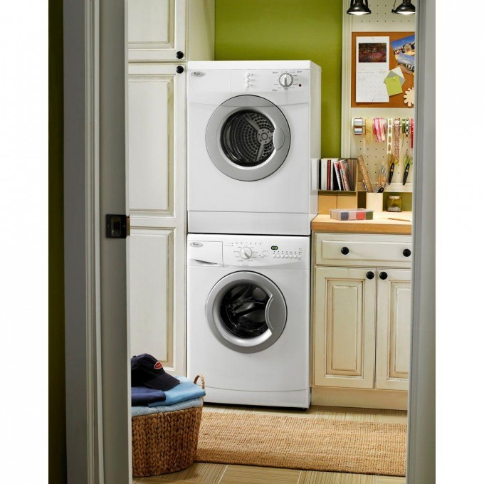White Stackable Washer And Dryer Next To A White Cabinet On A Room With Green Wall Ideas