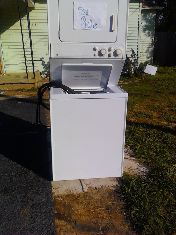 White Stackable Washer And Dryer On Outdoor Laundry