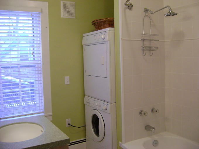 White Stackable Washer And Dryer With Bath Up And Shower Plus Sink And Green Wall Ideas