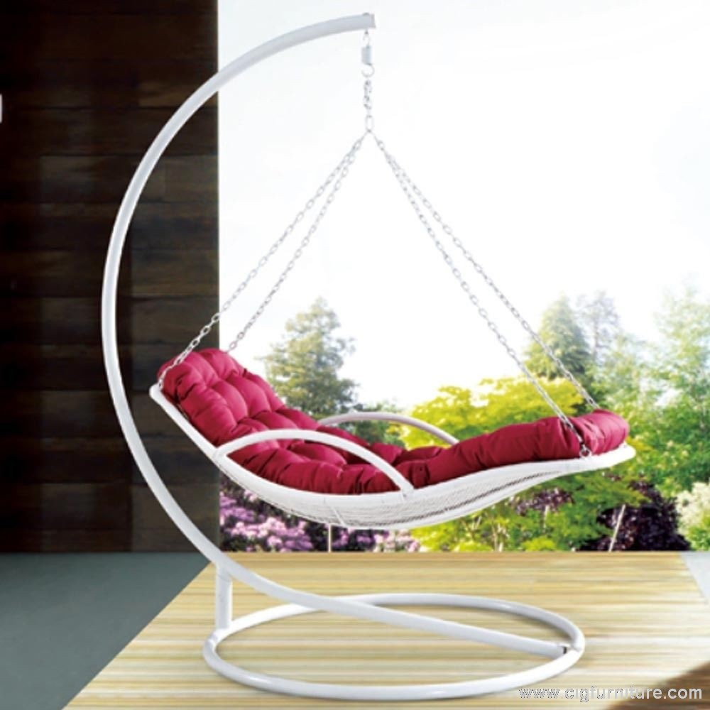 white swingasan chair with red cushion on wooden floor ideas