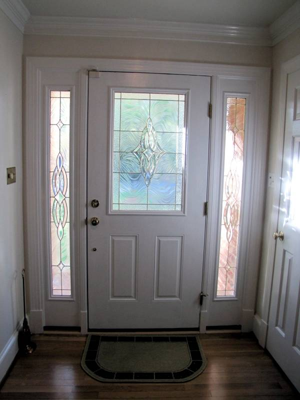 white therma tru entry doors with silver dorknob handle matched with white wall and wooden floor plus doormat ideas