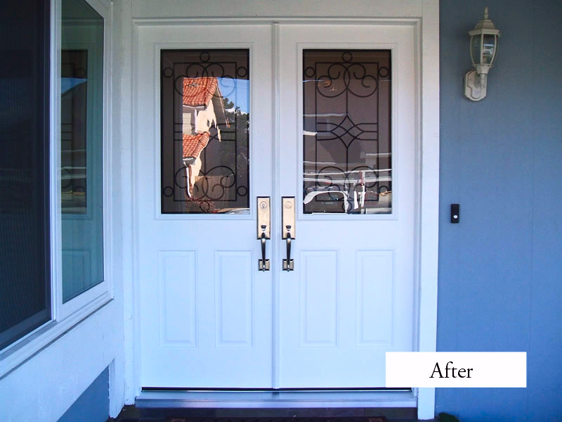 white therma tru entry doors with silver handle matched with blue wall plus chandelier ideas
