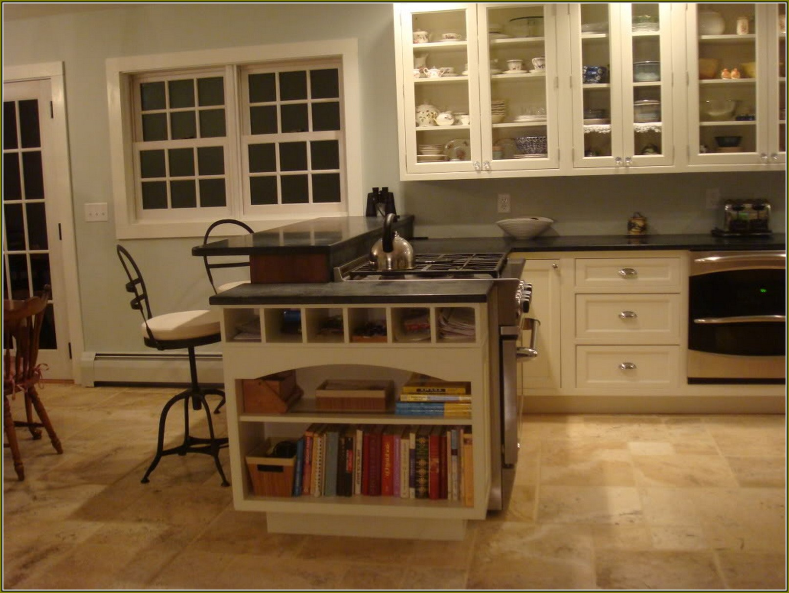 white Thomasville Cabinets with black countertop and silver handle plus book shelves for smart kitchen furniture ideas