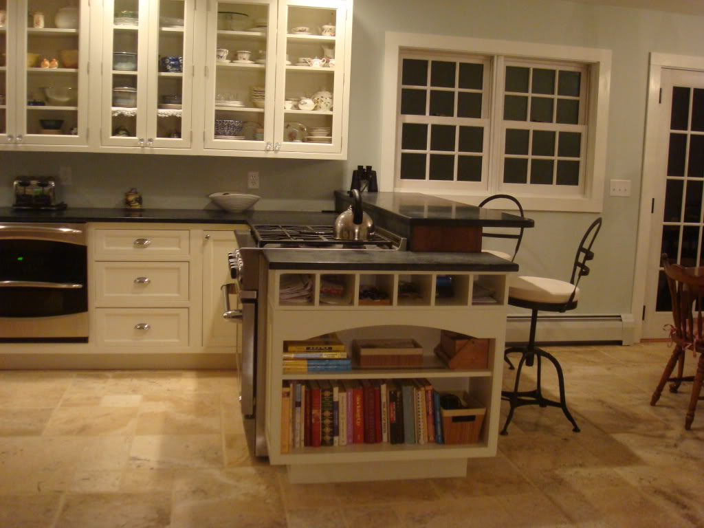 white Thomasville Cabinets with black countertop on cream floor plus desk for modern kitchen decoration