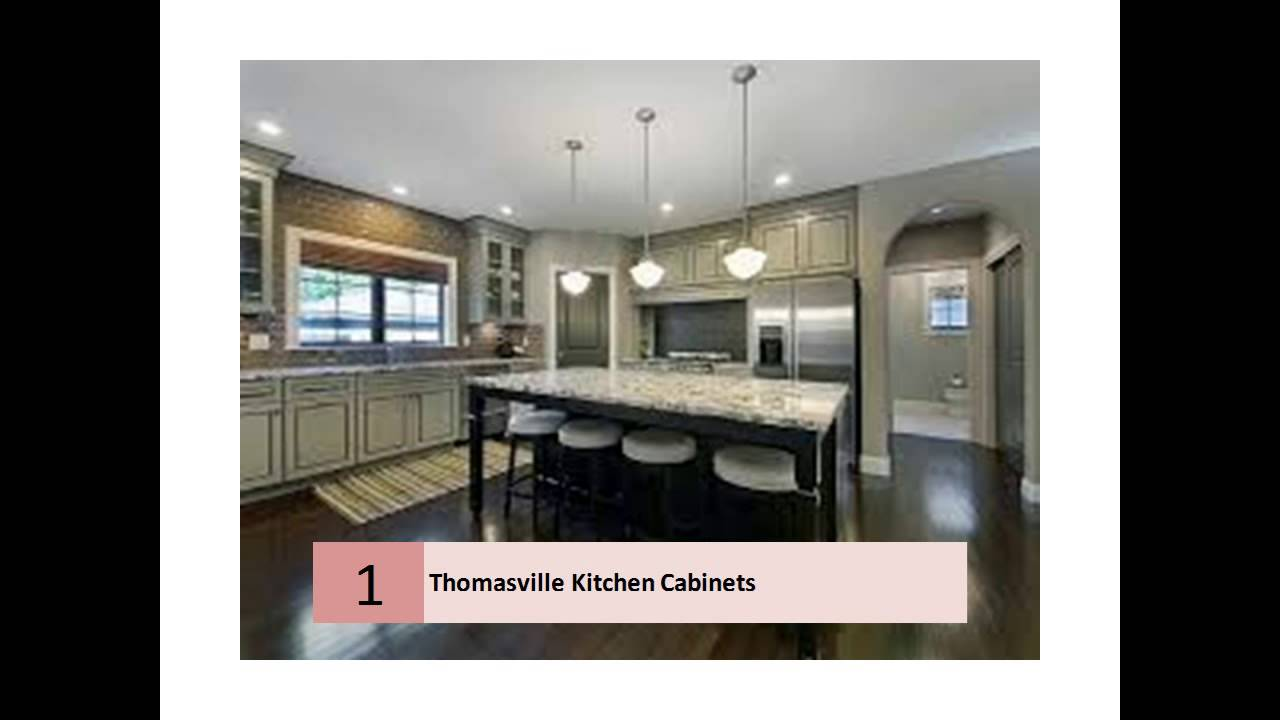 white Thomasville Cabinets with oven and fridge on wooden floor for kitchen decor ideas