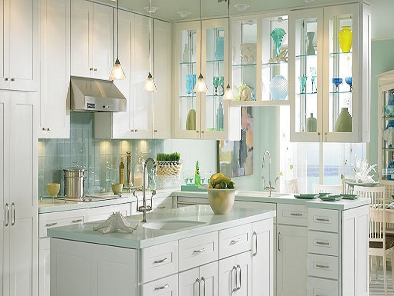 white Thomasville Cabinets with white countertop and ceramic tile back splash plus oven and fridge for kitchen decor ideas