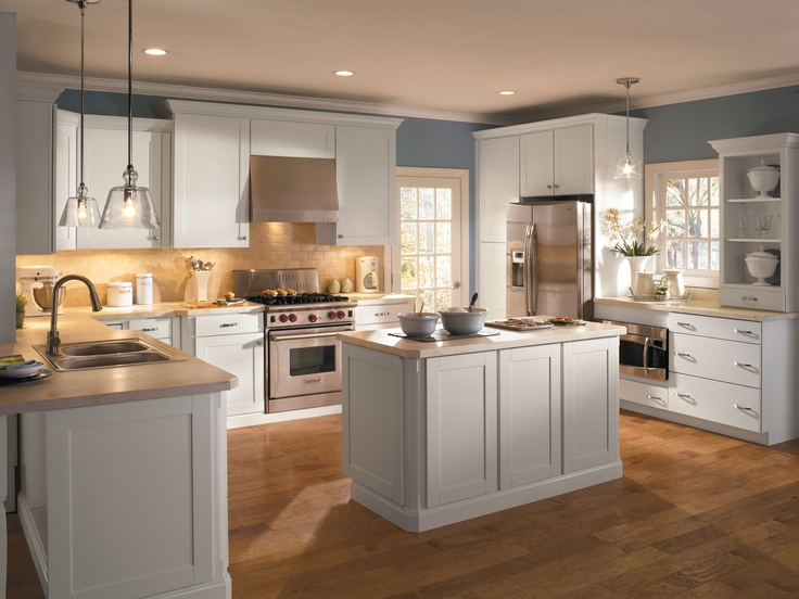 white Thomasville Cabinets with white countertop and cream back splash plus oven and fridge for kitchen furniture ideas