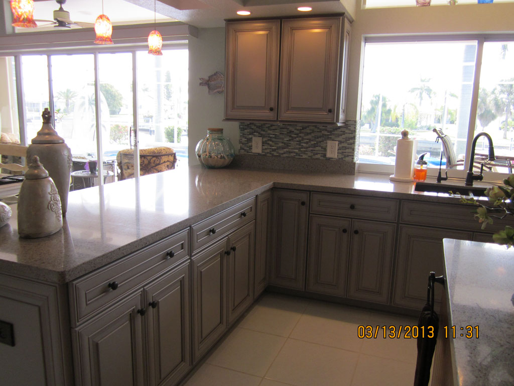 white Thomasville Cabinets with white countertop plus sink on white floor for kitchen decor ideas