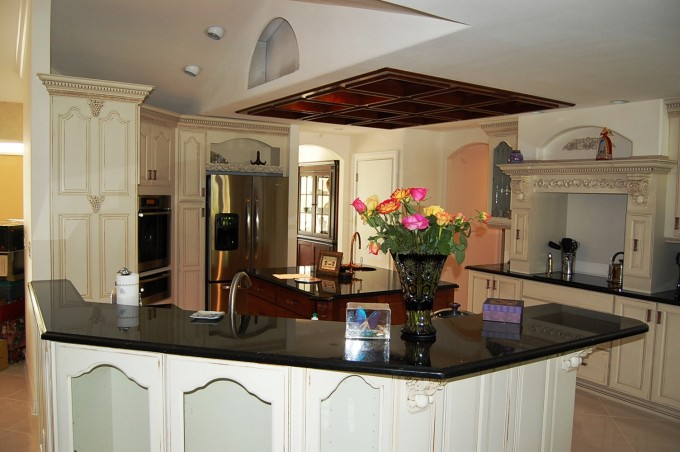 White Wellborn Cabinets With Black Countertop Plus Sink With Faucet Ideas