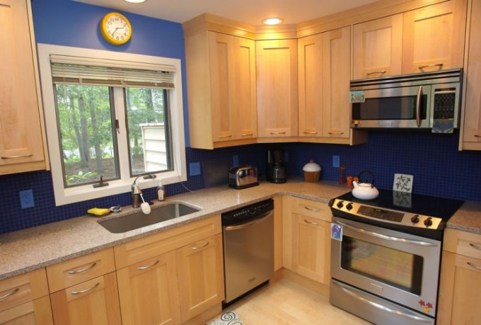 Winsome Black Merillat Cabinets Plus Oven With Blue Wall And Wooden Floor For Kitchen Inspiration