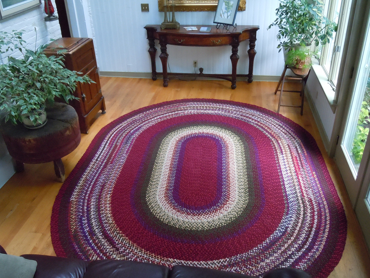 wonderful big braided rugs in oval design on wooden floor for lovely family room ideas