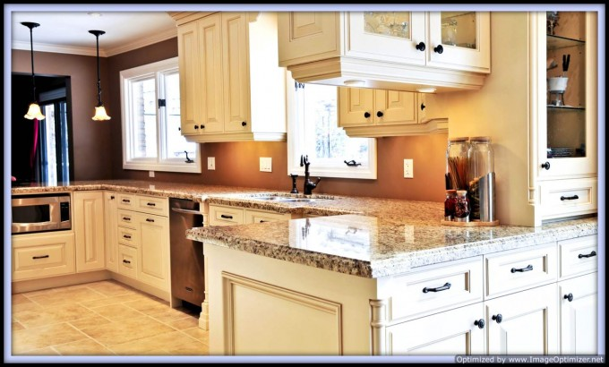 Wonderful White Kitchen Cabinet Refacing With Nice Countertop Plus Sink With Black Kitchen Faucet Plus Orange Wall For Amazing Kitchen Ideas