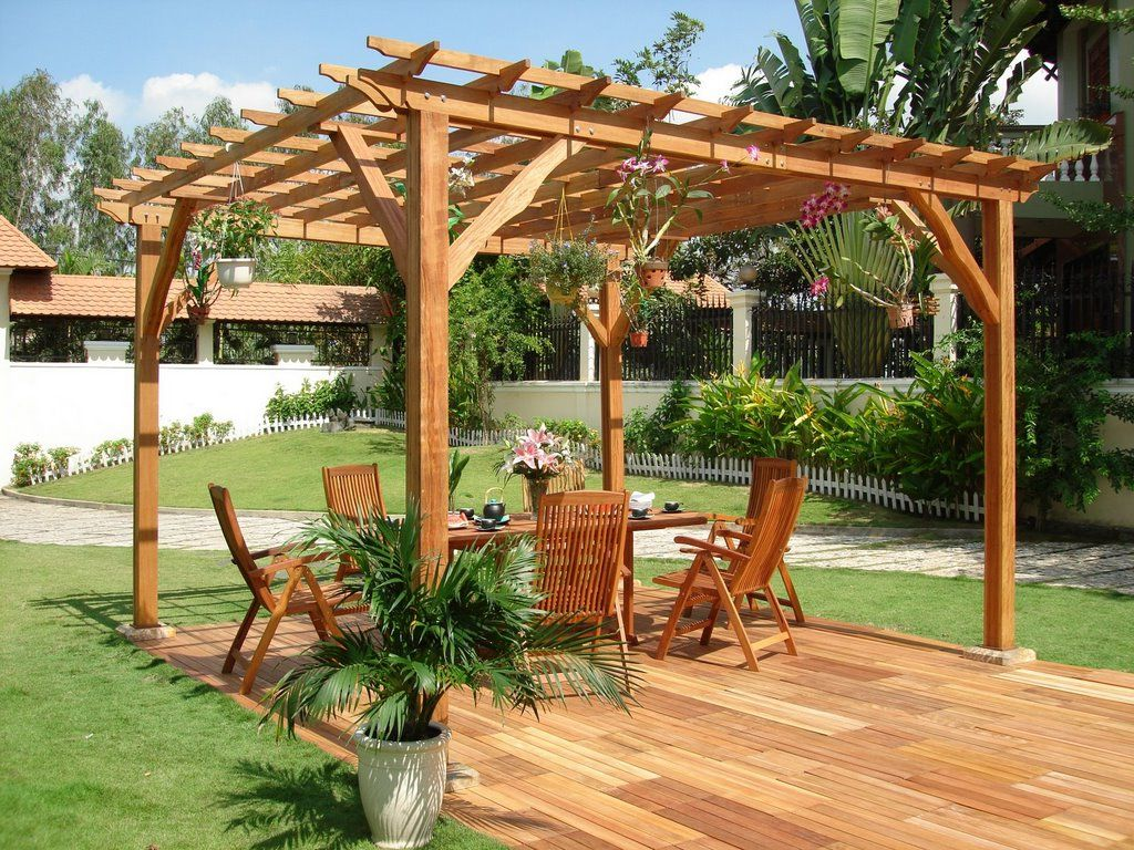 wood Pergola plans ideas with wooden chairs and wooden floor for more beautiful garden ideas