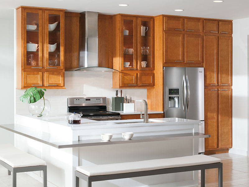 wooden Aristokraft Cabinets With white countertop plus oven and frige for kitchen decor ideas