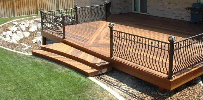 Wooden Evergrain Decking Matched With Iron Railing For Patio Ideas
