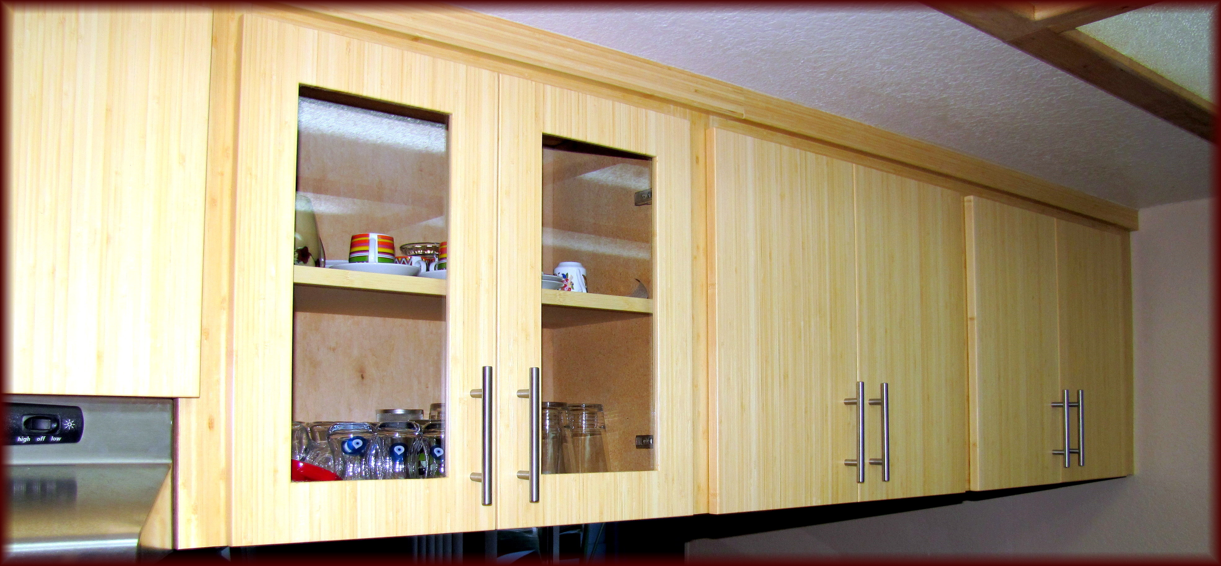 Wooden Kitchen Cabinet Refacing With Silver Handle Filled With Glass