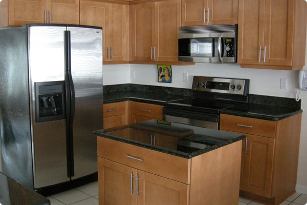 wooden kitchen cabinet refacing with stainless steel handle and black countertop plus frige and oven