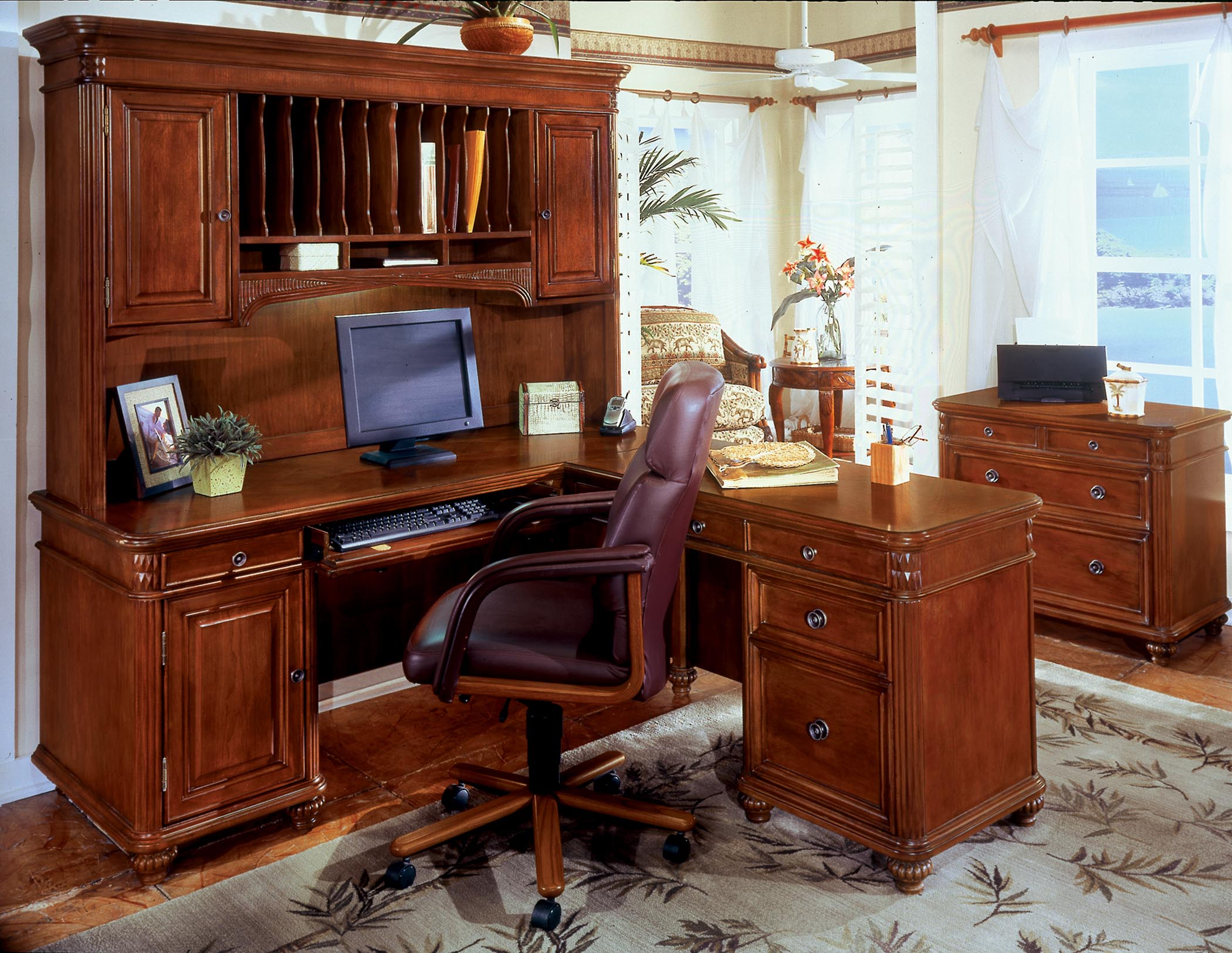 wooden L Shaped Desk with Hutch and drawer plus computer set and armchair on an home office area with wooden floor and carpet