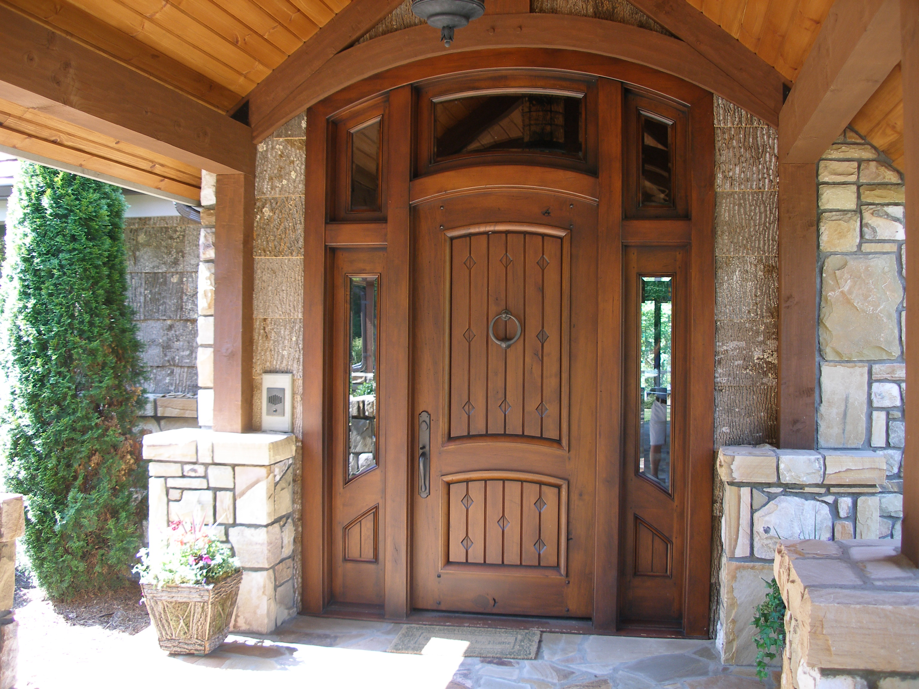 wooden pella windows and door matched with tan ceramics wall plus chandelier for exterior ideas