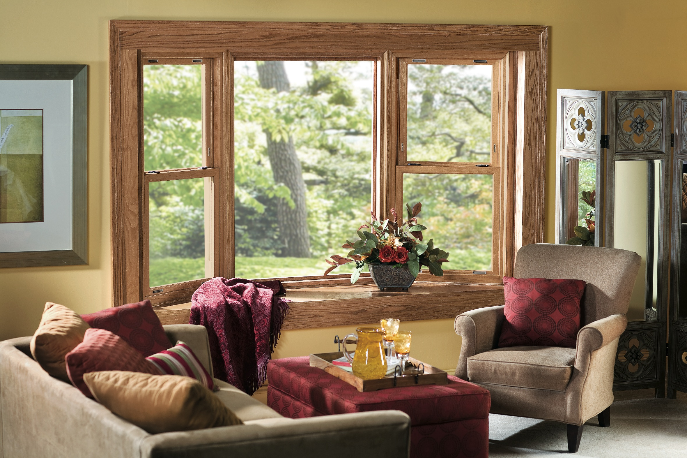 wooden pella windows matched with yellow wall plus sofa set with red cushions for family room ideas