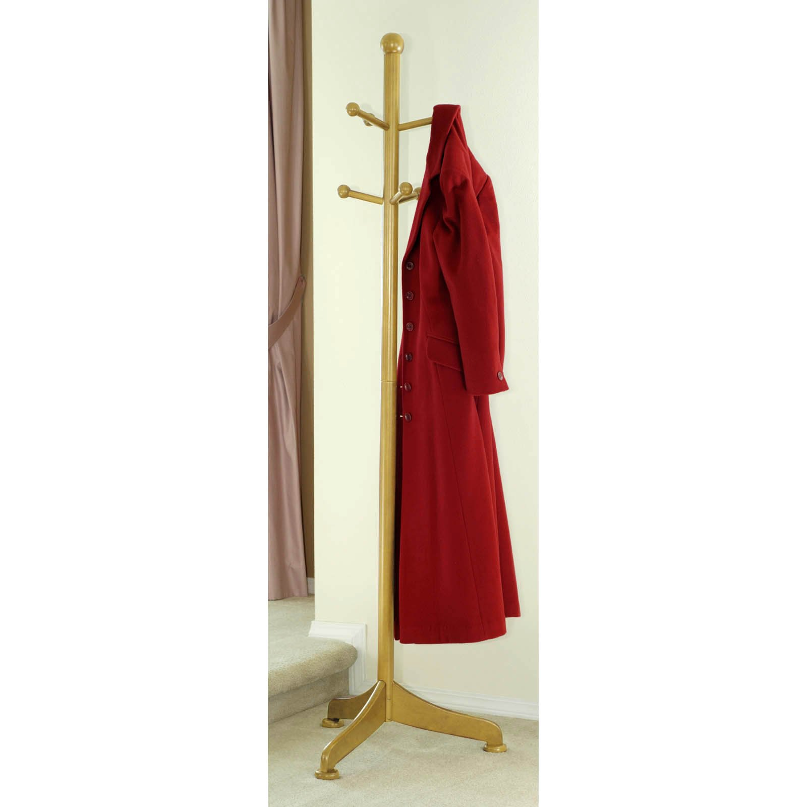 yellow standing coat rack with six hooks and single red coat hanged