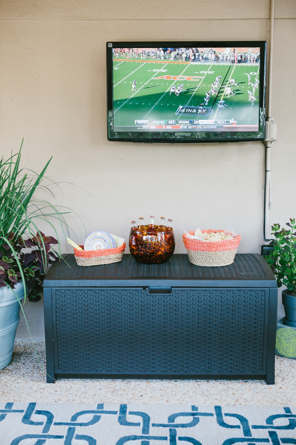 A Family Outdoor Space for Fall decor with black Suncast Deck Box Ideas plus tv on white wall ieas