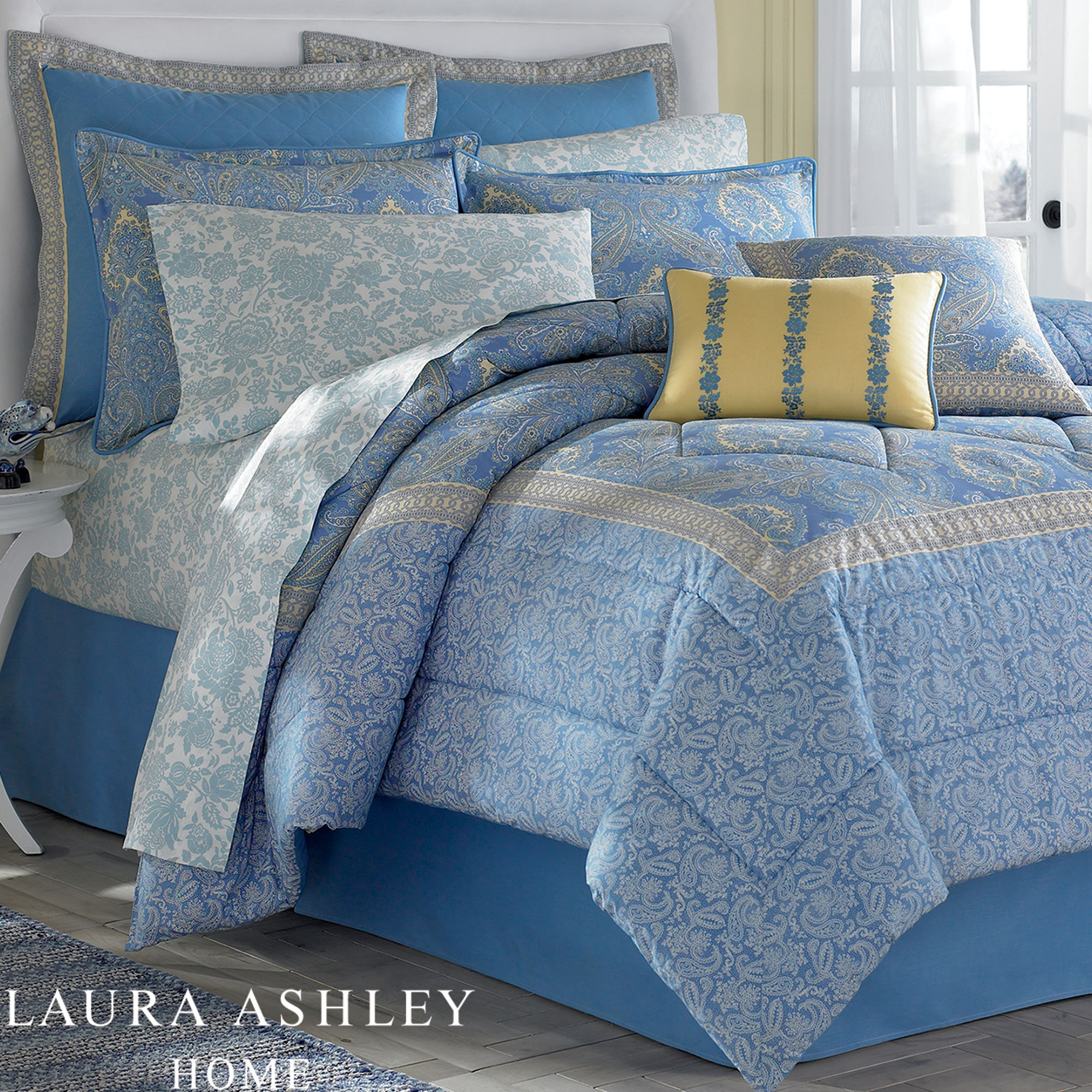 acharming laura ashley bedding in blue and floral pattern plus pillows on grey floor for bedroom decor ideas