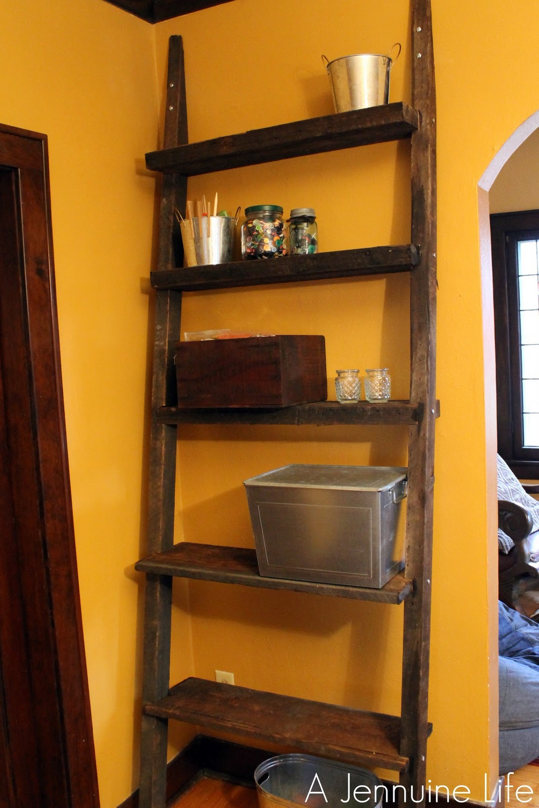 Amazing brown wooden Ladder Bookshelf before the orange wall for home decor ideas