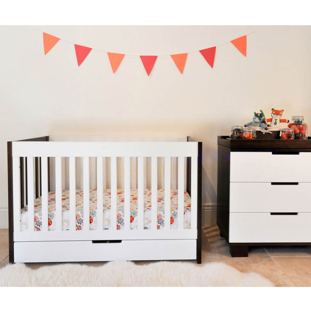 Babyletto Hudson White 3in1 Convertible Crib On Sandy Brown Ceramics Floor Plus White Carpet For Nursery Decor Ideas