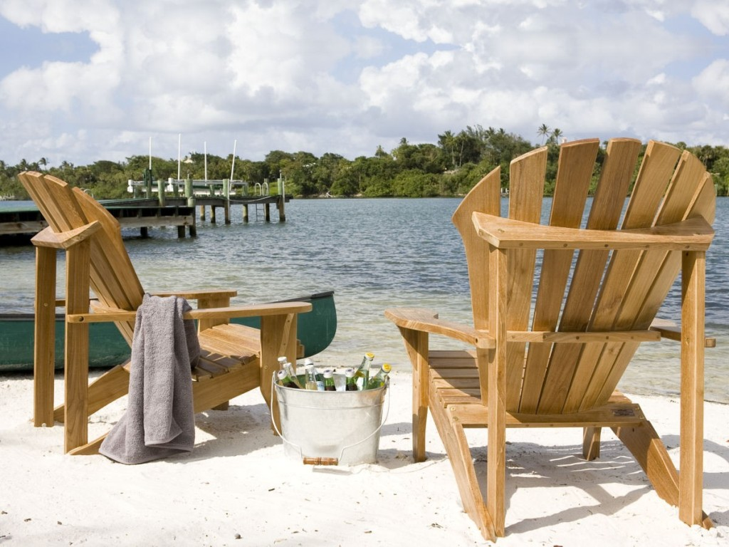 Beautiful Teak Adirondack Chairs on white sand near the beach for beautiful place ideas