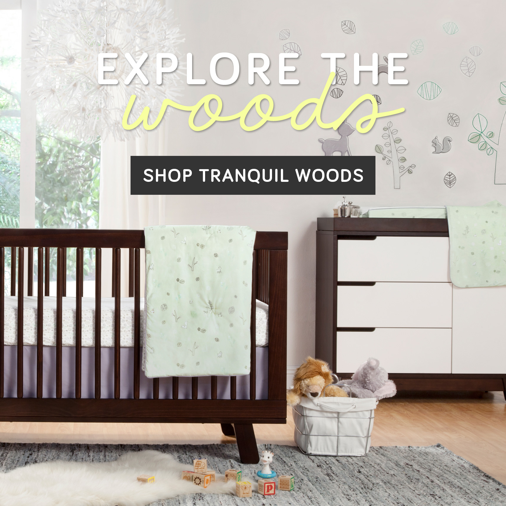 Bedding by Babyletto on wooden floor plus grey carpet for nursery decor ideas