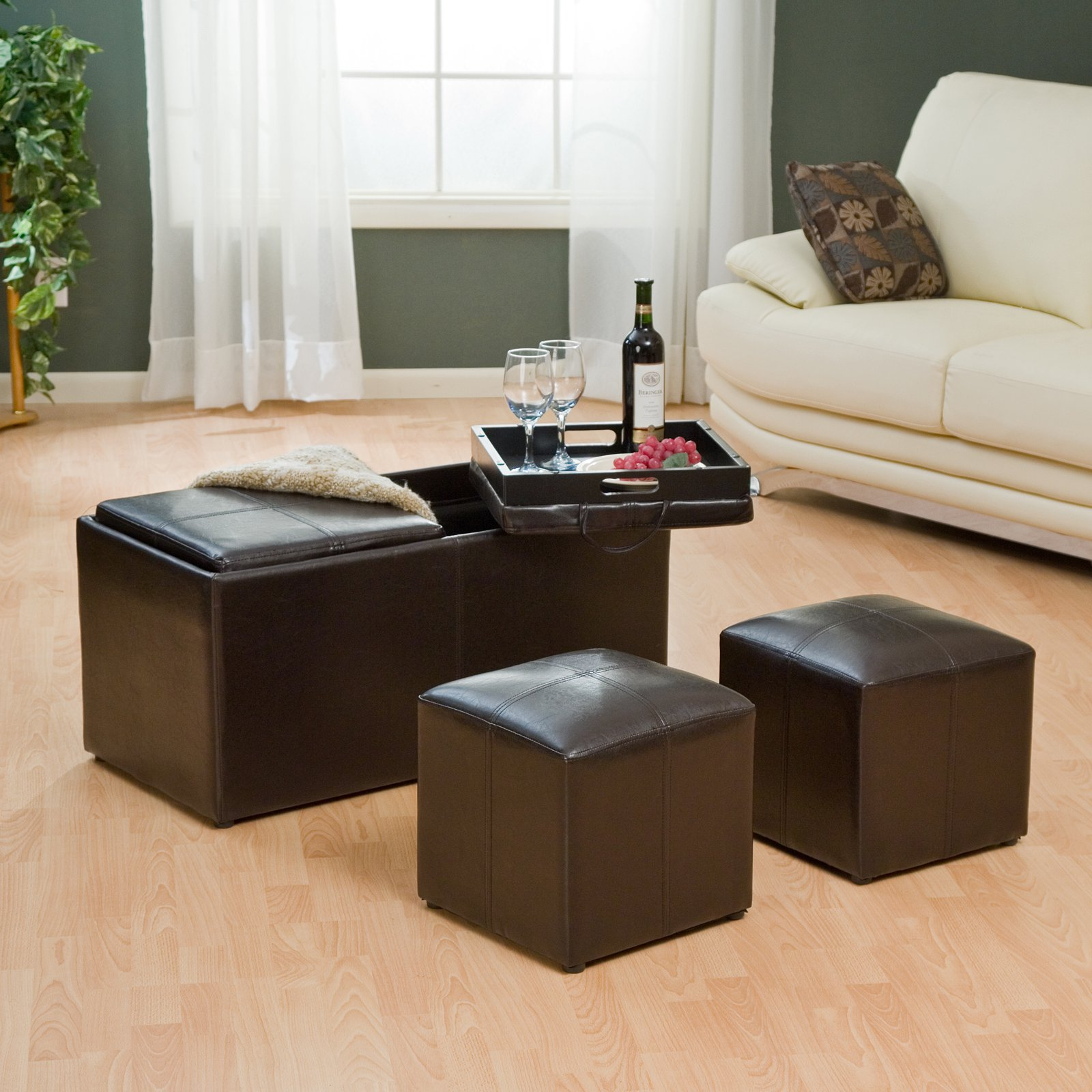 Black Large Ottoman Tray On Black Leather Ottoman On Wooden Floor Plus White Sofa Plus Cushion Before The Grey Wall With White Window Plus White Curtain For Living Room Decor Ideas
