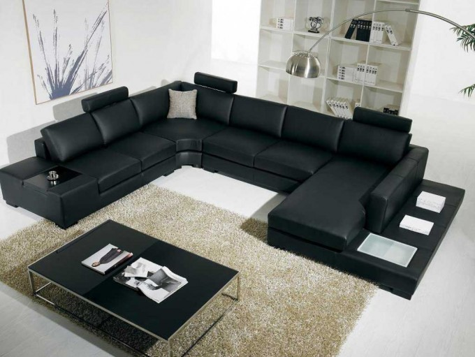 Black Leather Sectional Sleeper Sofa In U Shaped Design On White Ceramics Floor With Cream Rugs Plus Floor Standing Lamp For Inspiring Living Room Decor Ideas