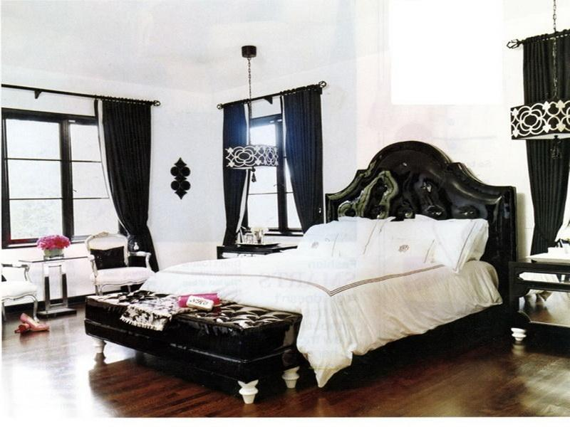 black leather upholstered headboards matched with white bedding on wooden floor matched with white wall plue chandelier for bedroom decor ideas