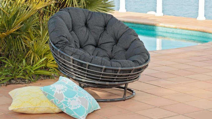 Black Rattan Outdoor Papasan Chair With Black Tufted Cushion Seat Near The Swimming Pool For Patio Decor Ideas