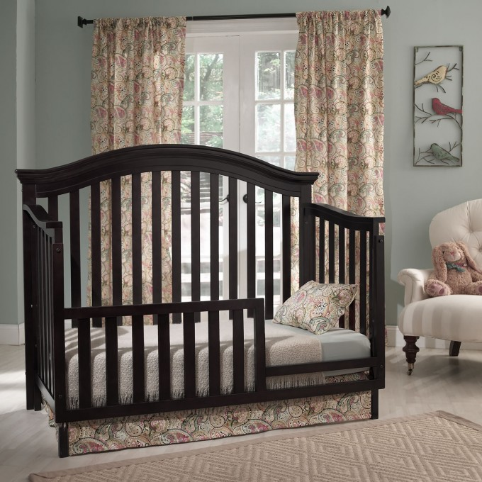 Black Wooden Crib By Munire Crib On White Floor Plus Cream Carpet Matched With Blue Wall With Floral Curtain For Nursery Decor Ideas